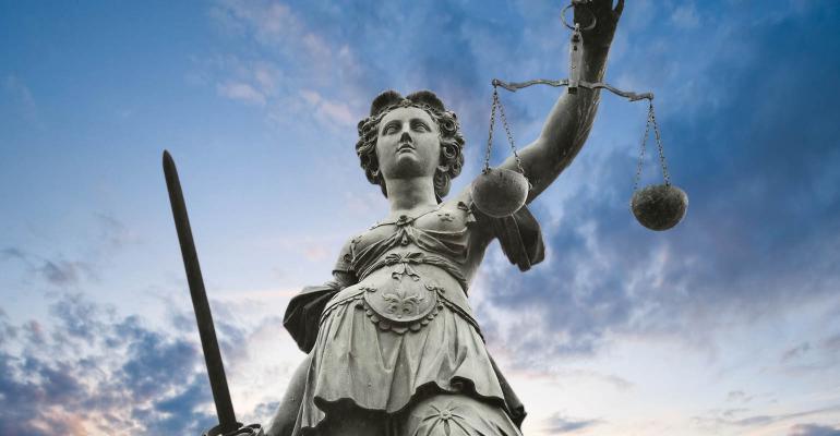 TE0220_kolasa scales of justice Getty Images-104383981.jpg