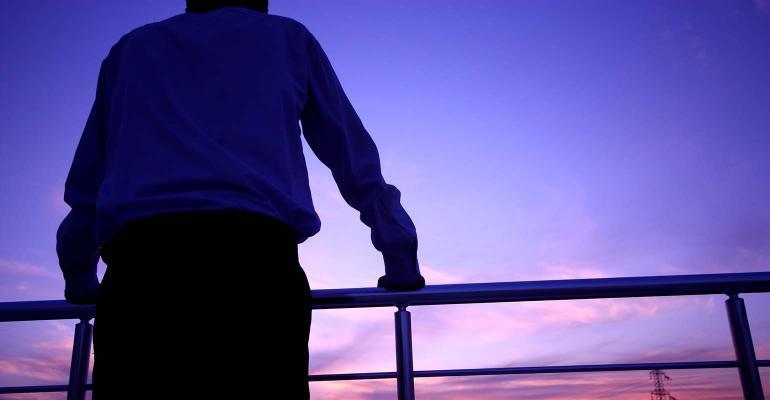 businessman-balcony-sunset.jpg