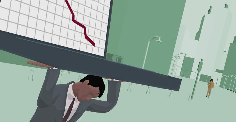 businessman carryiing laptop showing downward trend