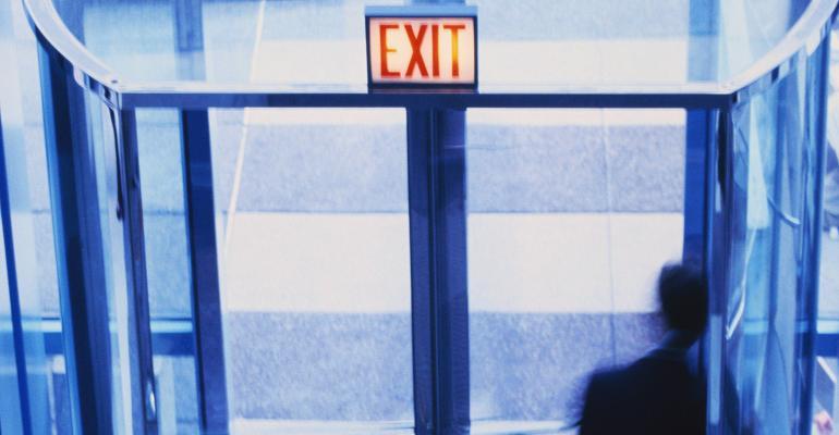businessman-exit-sign-revolving-door.jpg