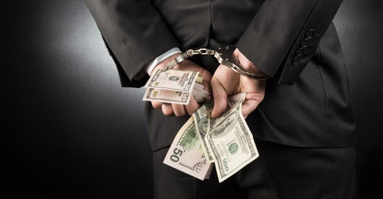 businessman handcuffs money