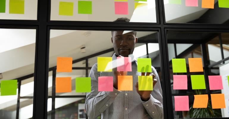 businessman-postits-wall.jpg