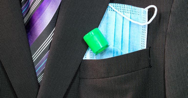 businessman-suit-mask-sanitizer.jpg