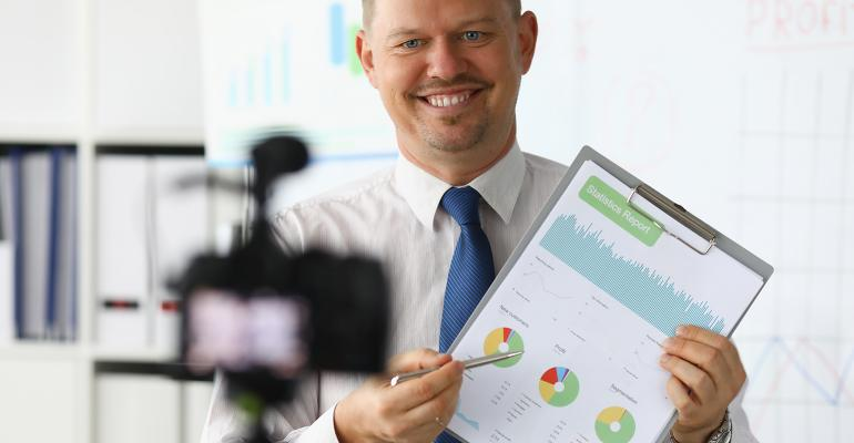 businessman-video-camera.jpg