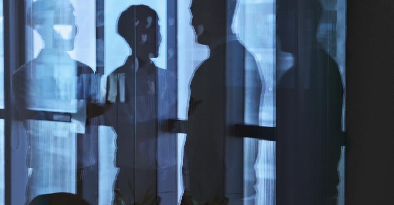 businessmen-reflection-window.jpg
