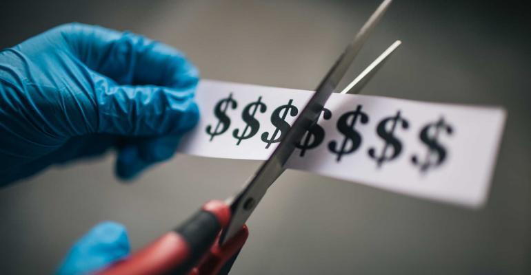 scissors cutting dollar signs