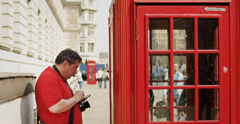 using smartphone outside phonebooth
