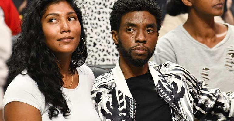 Taylor Simone Ledward and Chadwick Boseman at a Los Angeles Clippers game in 2019.