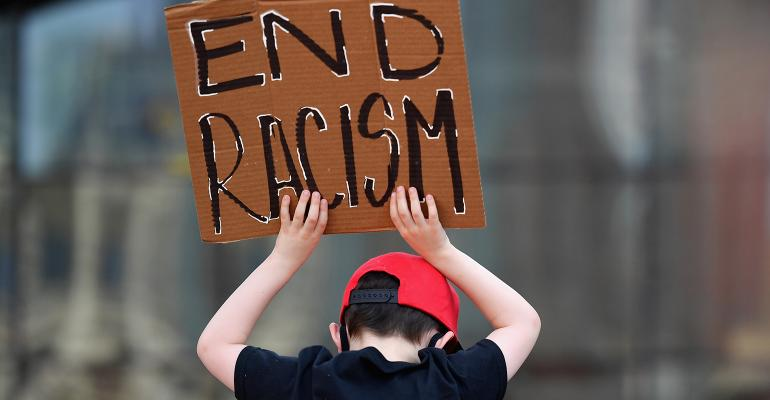 child-holding-end-racism-sign.jpg