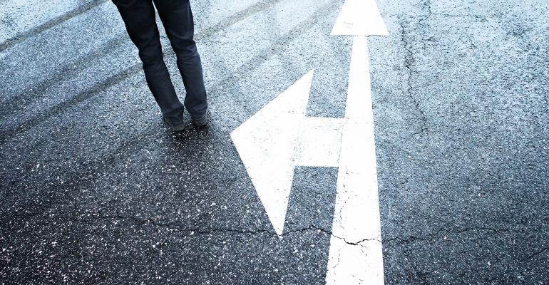 crossroads businessman walking