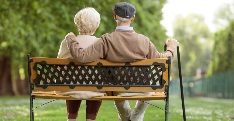 elderly couple park bench