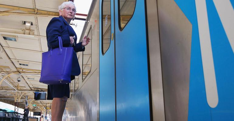 elderly woman waiting on train