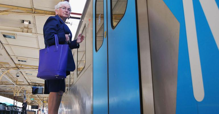 elderly woman waiting on train