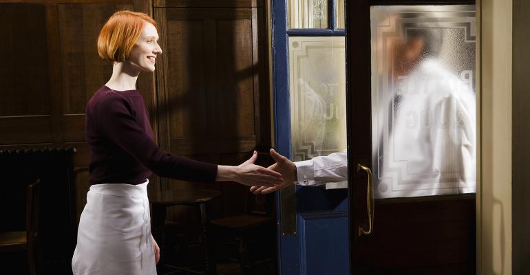 handshake-woman-man-doorway.jpg