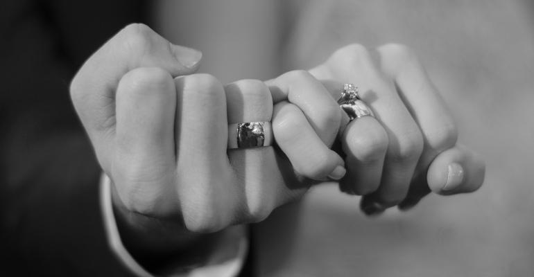 holding hands wedding rings