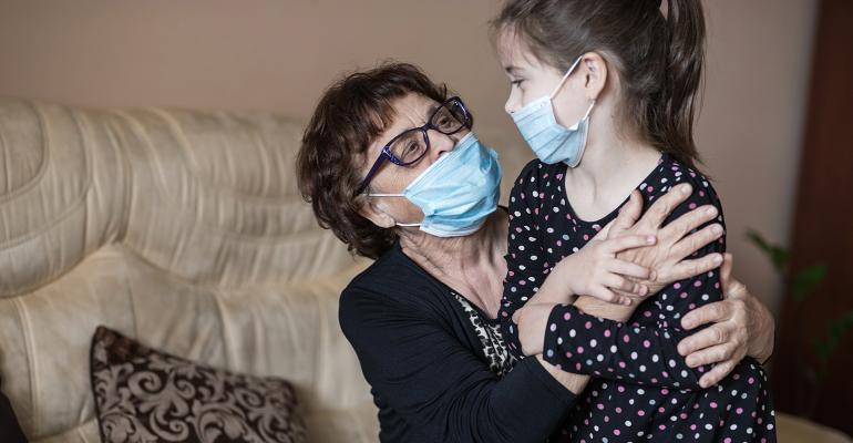 hugging-grandchild-mask-coronavirus.jpg