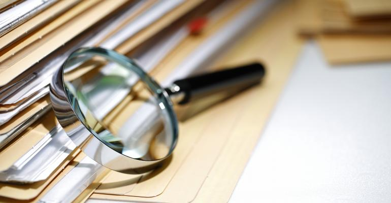 magnifying glass paperwork