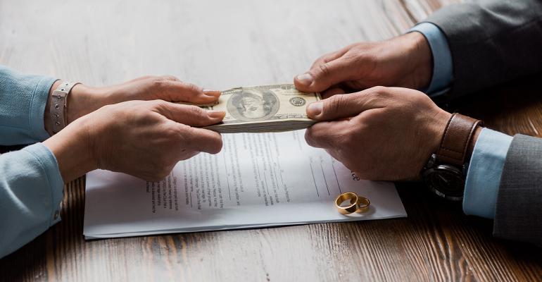 man-woman-fighting-money-wedding-rings.jpg