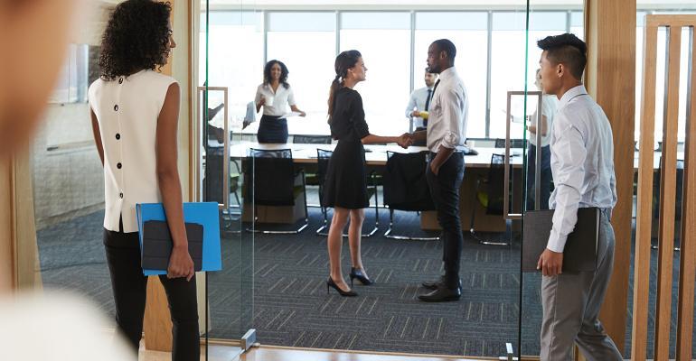 man-woman-handshake-boardroom.jpg
