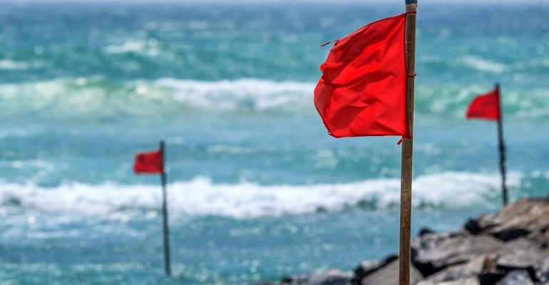 red warning flags on beach