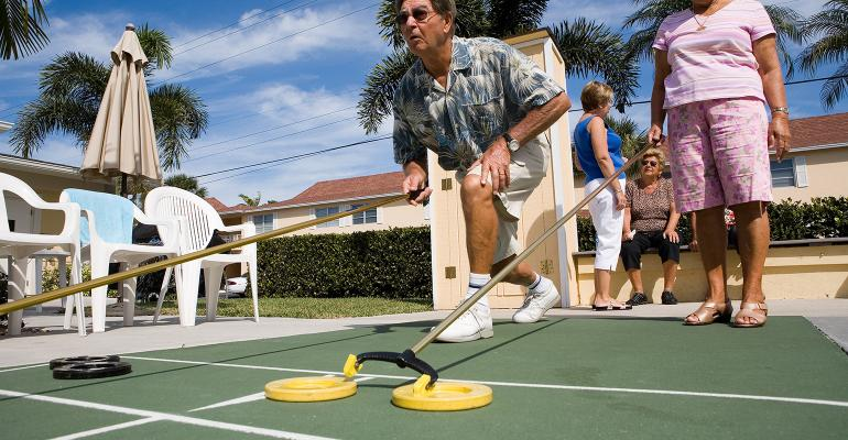 retirees playing shuffleboard