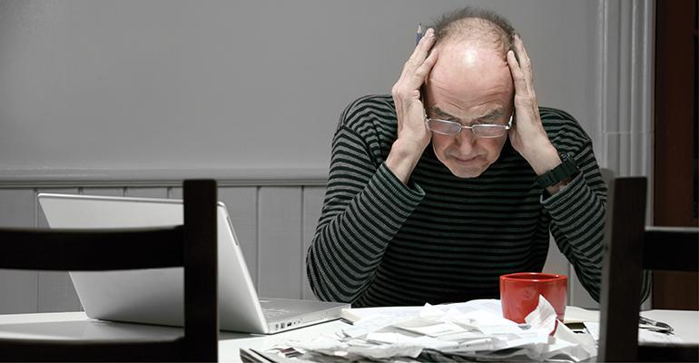 elderly man paperwork