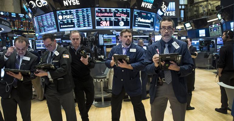 stock market traders standing