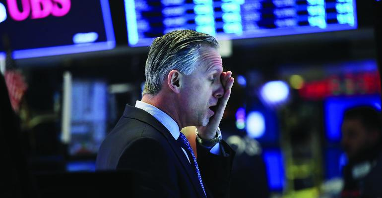 stock trader hand to face