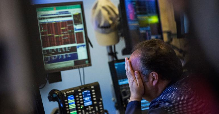 stock market trader hands on face