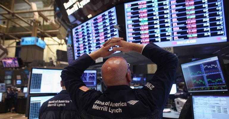 stock market trader hands on head