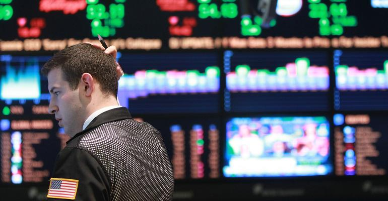 stock trader scratching his head