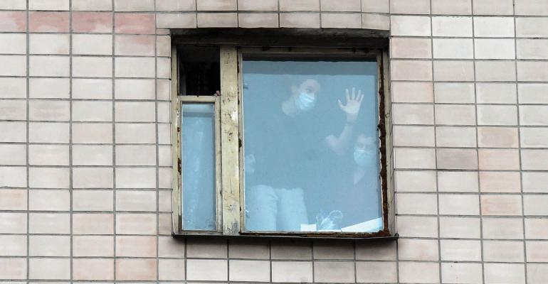 students in dorm wearing masks