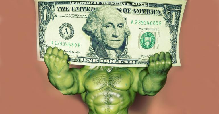 superhero holding giant dollar bill