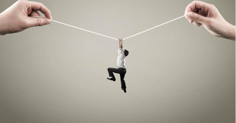 survival-man hangs from rope.jpg