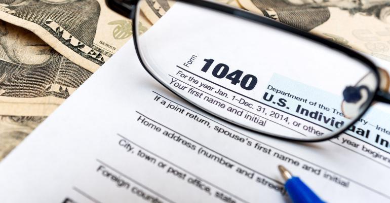 tax return glasses money