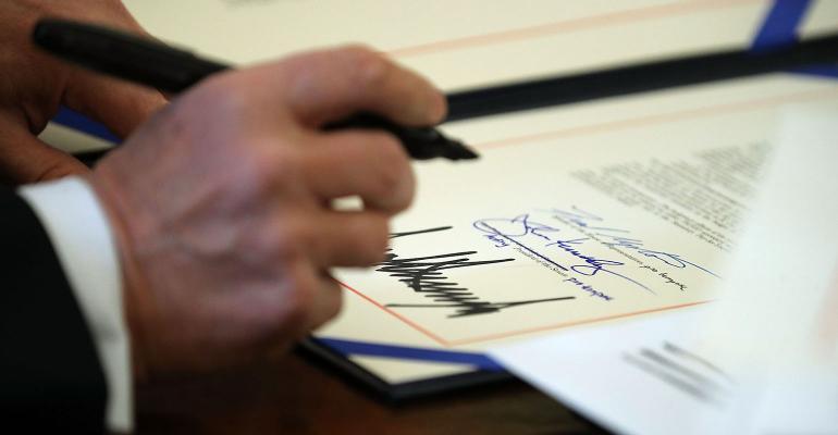 Donald Trump signing tax reform bill