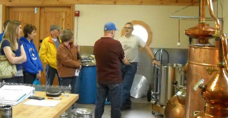 Chuck Morris leads a tour at The Hardware Distillery