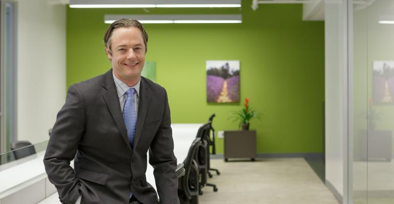 Chris Battreall at one of the work desks in Chicago will manage the new office