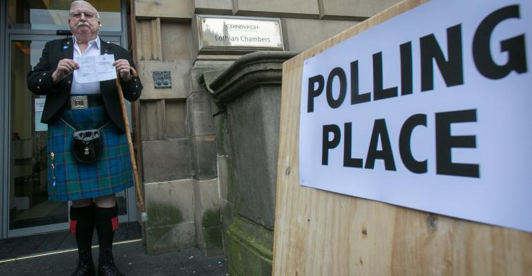 EDINBURGH SCOTLAND James Fraser holds up his voting card having just voted at Lothian Chambers polling station in central Edinburgh on September 18 2014