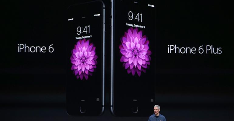 Apple CEO Tim Cook introduces the new iPhone 6 and iPhone 6 Plus on Tuesday