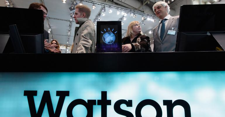 Visitors check out a slimmed down version of the IBM Watson supercomputer at the CeBIT technology trade fair on March 2 2011 in Hanover Germany