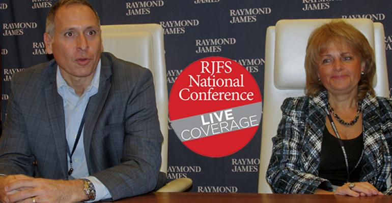 Vin Campagnoli and Bella Allaire at the Raymond James Financial Services national conference in Las Vegas