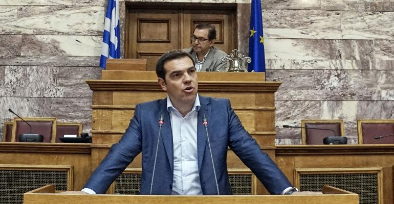 Greek Prime Minister Alexis Tsipras addresses his party members and ministers at the Greek Parliament on June 16 2015 in Athens Greece