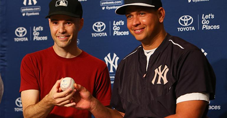 Zach Hample and Alex Rodriguez with the ball he hit for his 3000 career hit  Copyright Mike Stobe Getty Images