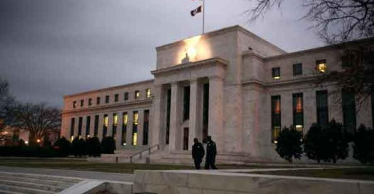 Fed Holds Rates at Zero; Projects Two Hikes by End of 2023