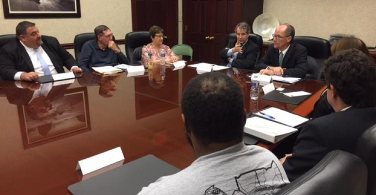 Sherrod Brown and Tom Perez at a roundtable discussion Monday in Cleveland