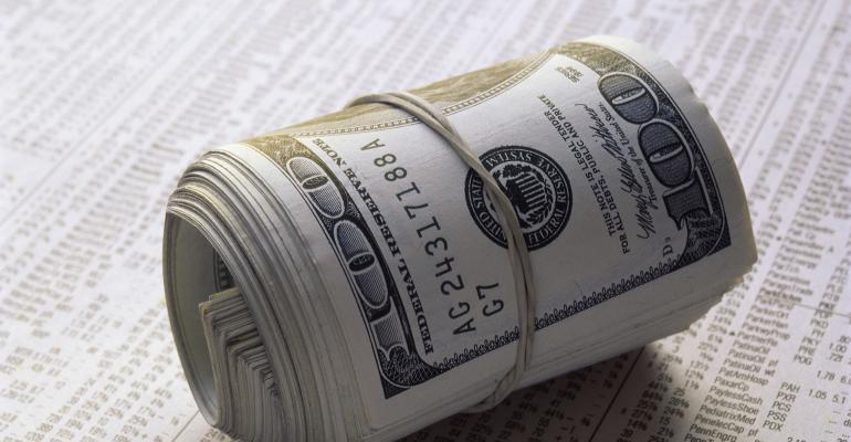 newspaper stock prices wad of money