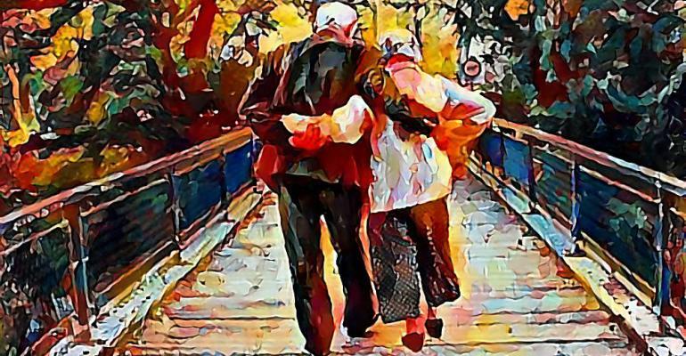 elderly couple crossing bridge