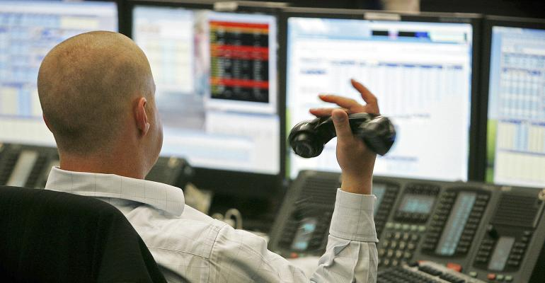 stock trader holding phone