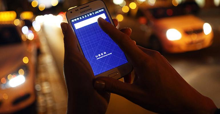 A prospective Uber user opens the companys app on a smartphone